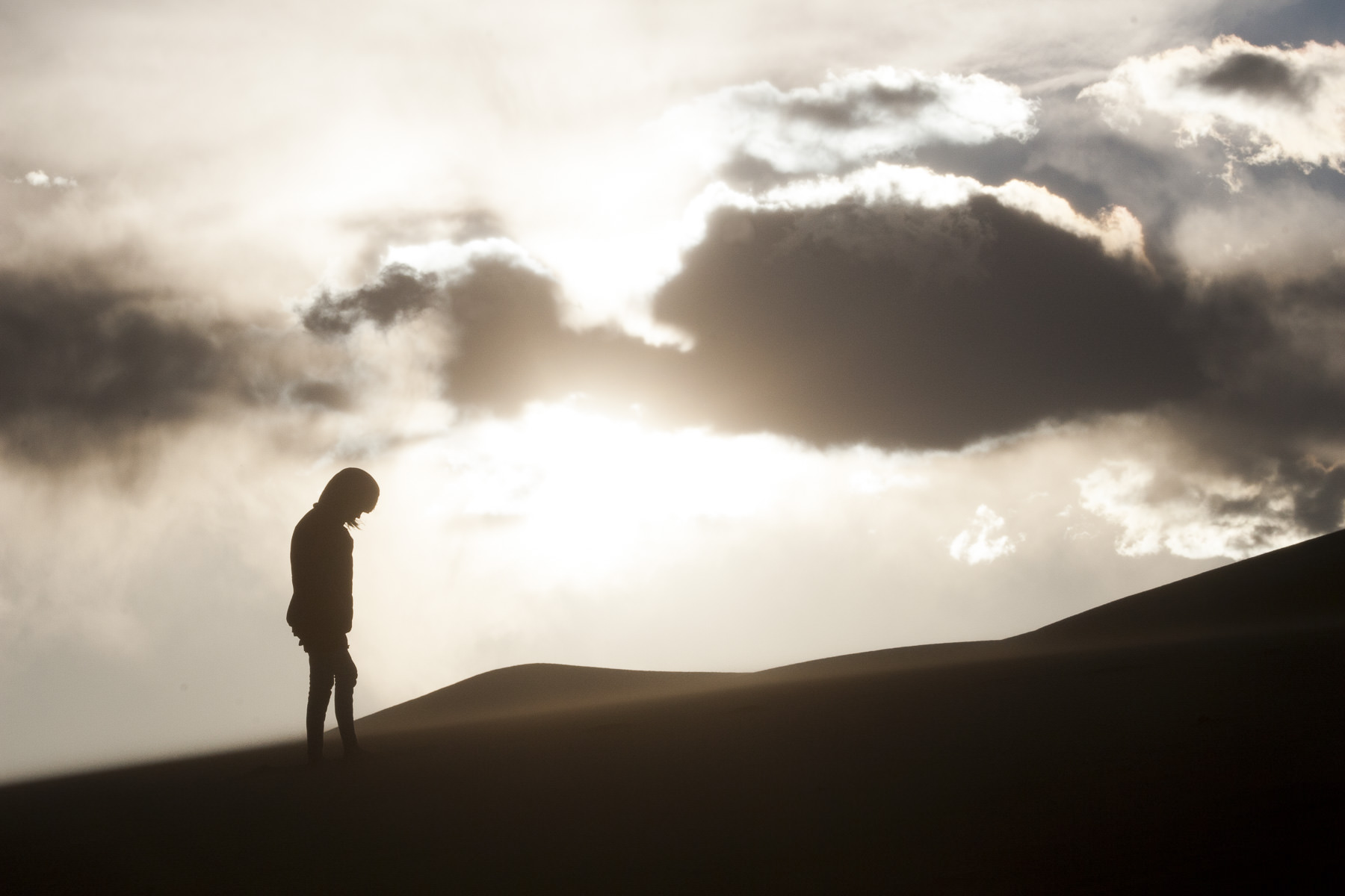 Girl stands on the Sand Dunes National Park in Colorado