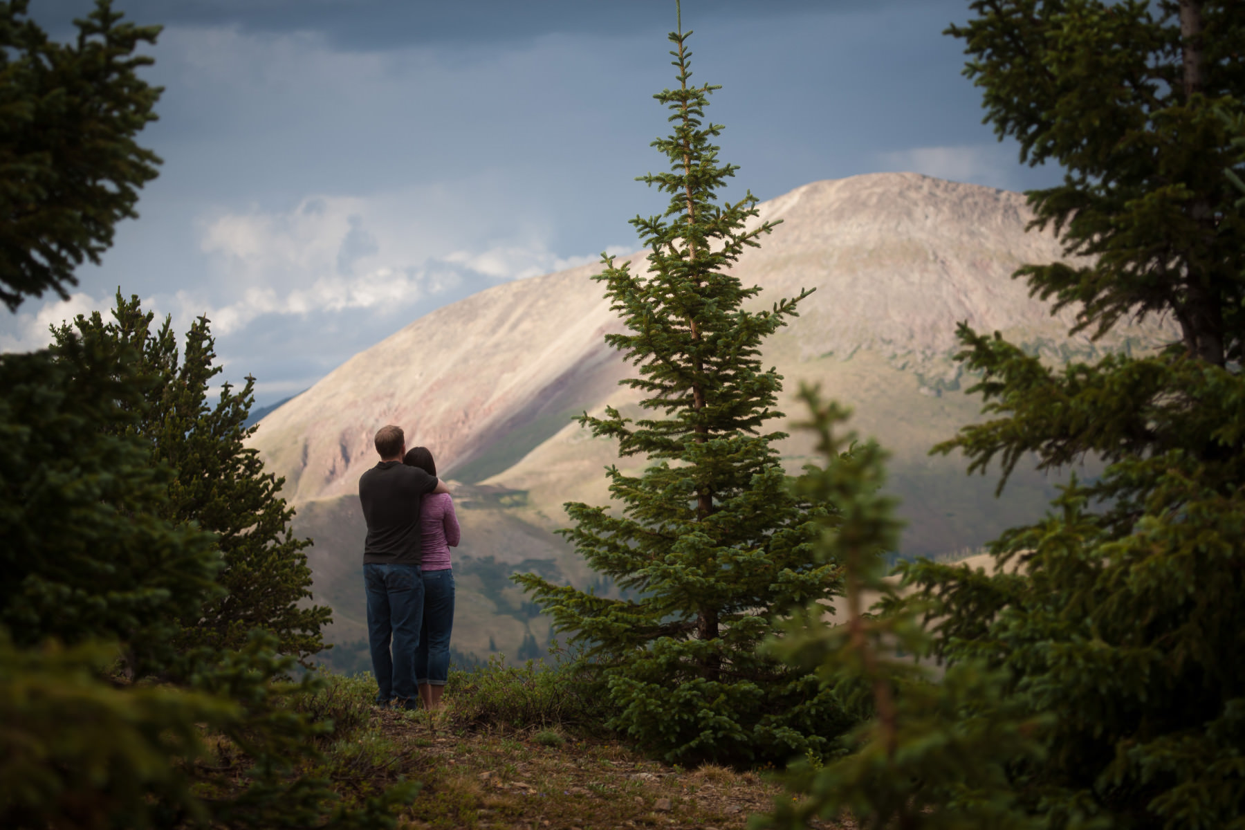 Couple embraces at sunset at Hoosier Pass