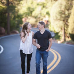 Couple walking together and laughing along the road at Garden of the Gods Park.