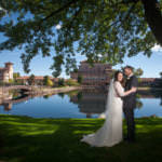Bride and groom embrace underneath an elm tree at The Broadmoor.