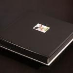 Fine Art Wedding Album with black leather cover and photo.