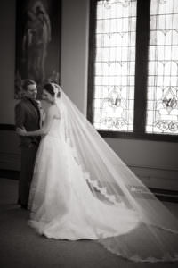 Black and white of bride and long wedding veil at Boulder Street Church.