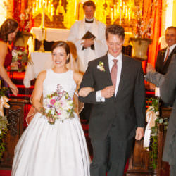 Bride and groom walk down the aisle after their wedding ceremony at Pauline Chapel.