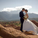 Bride and groom embrace at Garden of the Gods