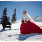 Bride and groom skiing together at Loveland Ski Area