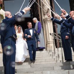 Saber arch for Air Force officer and bride at National Cathedral