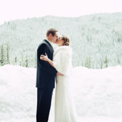 bride-groom-kiss-snow-forest-ski-tip-lodge-keystone-colorado