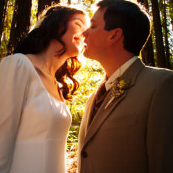 bride-groom-sunlit-kiss-redwood-grove-sonoma-county-wedding