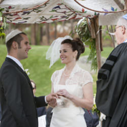 Bride and groom underneath Chuppah with Rabbi officiant during Jewish wedding ceremony at Keystone Ranch.