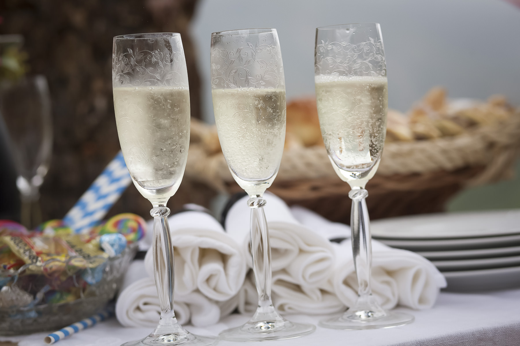 Champagne flutes with champagne and white napkis.