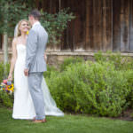 Bride and groom share an embrace after their wedding at Old Thompson Barn.