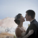 Bride and groom kiss in the snow at the Garden of the Gods Club.