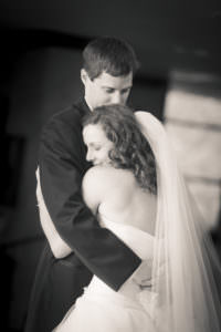 Black and white of bride and groom embracing at Cheyenne Lodge.