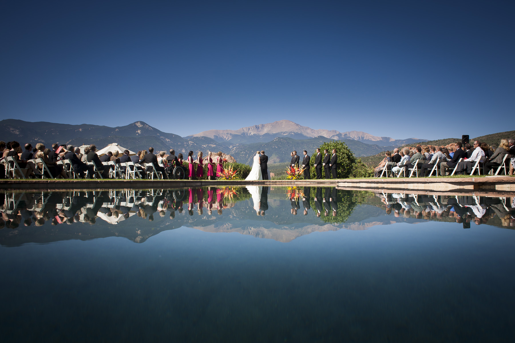 Wedding ceremony with reflection pool, Garden of the Gods park and Pikes Peak.