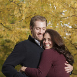 Alexis and Eric embrace in front of turning Cottonwoods.
