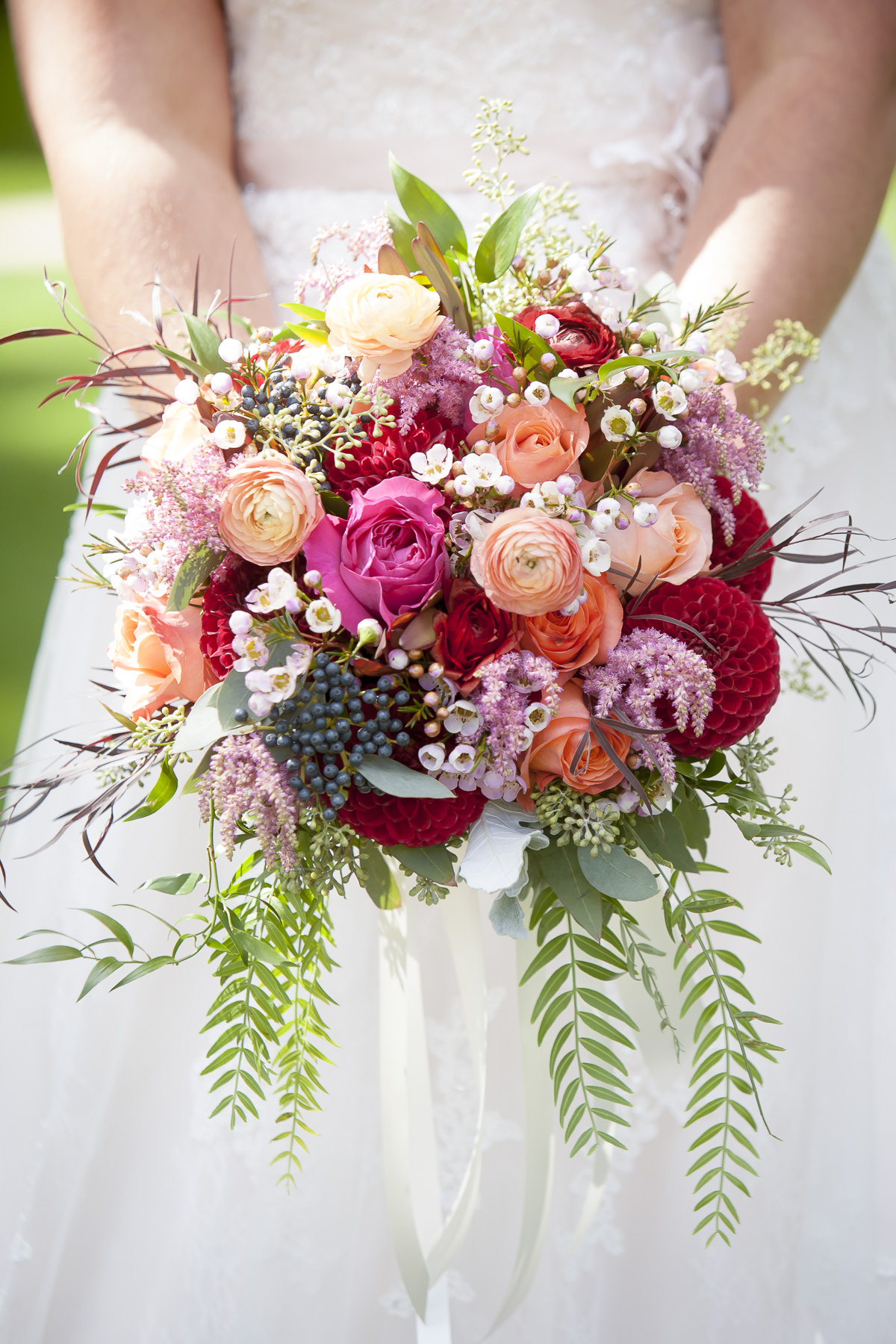 Wedding bouquet with red and pink peonies by Colorado wedding florist Twigs + Posies