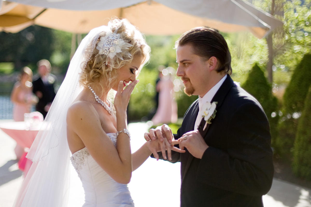 Bride reacts to groom presenting wedding ring at The Broadmoor.